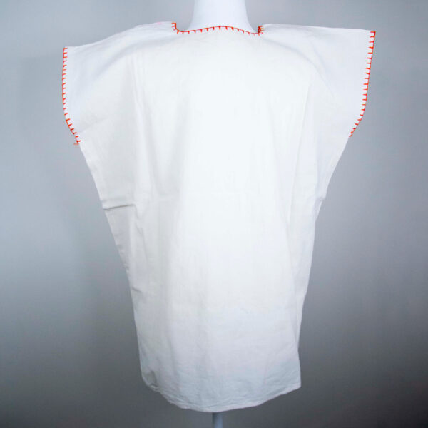 Back view of a Traditional handmade Mexican embroidered white blouse made of cotton on a mannequin