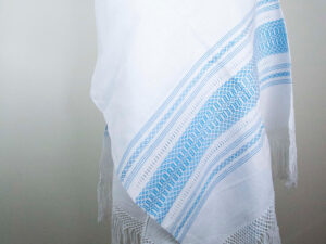 Front view of a Traditional Handwoven Mexican White and blue Shawl Scarf Wrap made of cotton on a mannequin