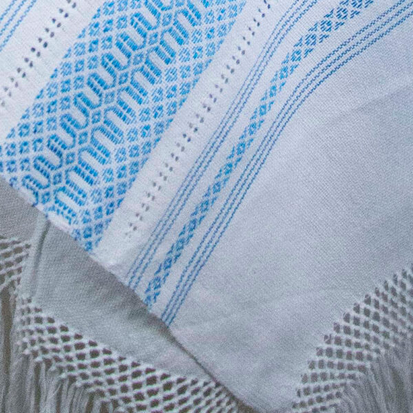 Detail view of a Traditional Handwoven Mexican White and blue Shawl Scarf Wrap made of cotton