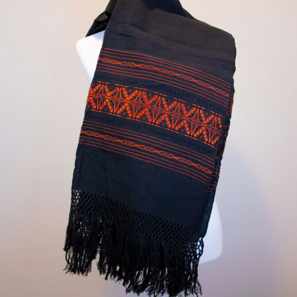 Front view of a Traditional Handwoven Mexican black and orange Shawl Scarf Wrap made of cotton on a mannequin