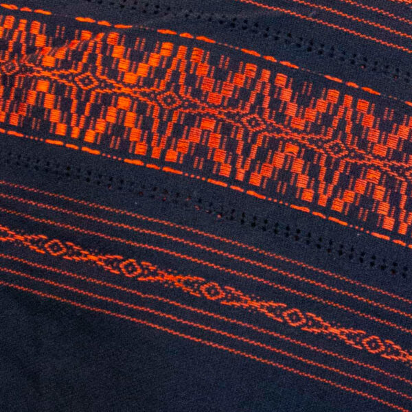 Detail view of a Traditional Handwoven Mexican black and orange Shawl Scarf Wrap made of cotton
