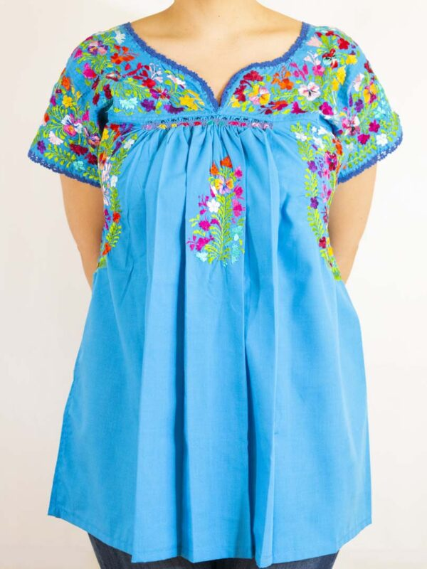 Girl wearing Handmade Traditional Mexican Blue Blouse with Hand-embroidered flowers-007