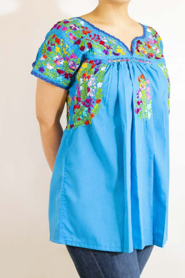 Girl wearing Handmade Traditional Mexican Blue Blouse with Hand-embroidered flowers-008
