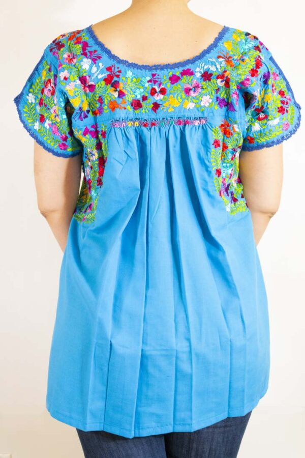 Girl wearing Handmade Traditional Mexican Blue Blouse with Hand-embroidered flowers-009